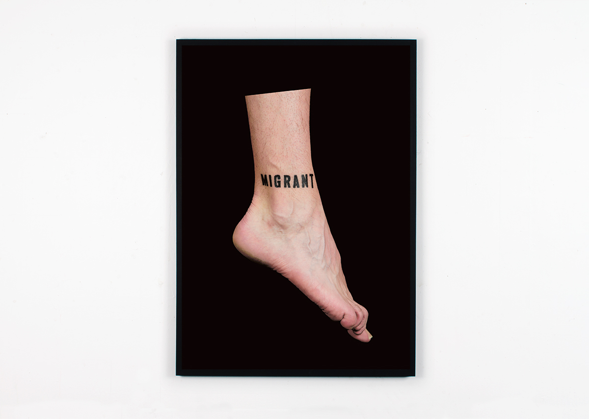 David Blackmore: Migrant (2017) Photographic document of the act of having the word MIGRANT tattooed on the artists ankle